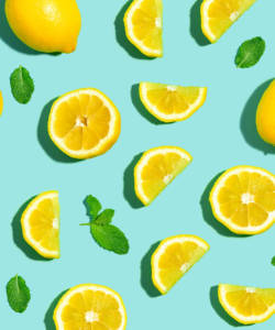 Fresh lemon pattern on a bright color background flat lay